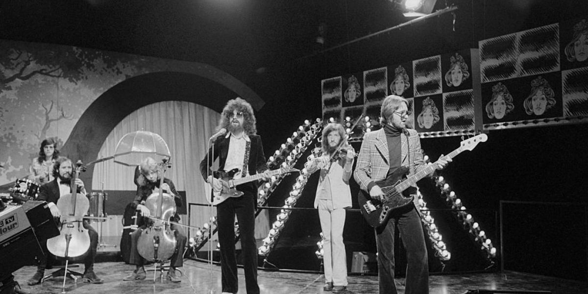 English pop group Electric Light Orchestra (ELO) rehearsing for their appearance on the BBC TV music show 'Top Of The Pops', London, 11th October 1973. The band are miming to their single 'Showdown'. Left to right: Bev Bevan (drums), Mike Edwards (1948 - 2010), Rick Pannell, Jeff Lynne, Mik Kaminski and Mike de Albuquerque. Pannell is the band's sound engineer and is standing in (miming only) as second cellist after the departure of Colin Walker from the group. (Photo by Michael Putland/Getty Images)