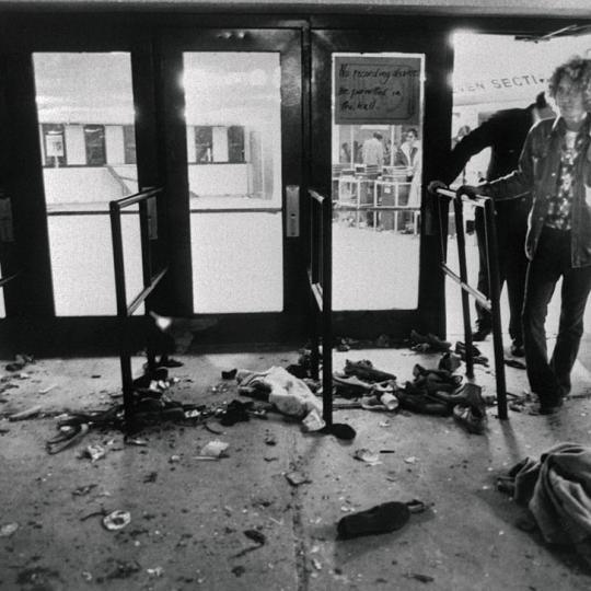 "Person Viewing Scene After Stampede (Original Caption) Debris litters the ground in front of the doors where 11 people were trampled to death as they attempted to enter the Riverfront Coliseum December 3rd for a concert by the rock group, The Who. Numerous injuries were also reported in what one survivor called a ""nightmare."""