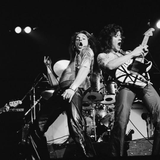 LONDON - 27th MAY: Van Halen perform live on stage at Lewisham Odeon in London on 27th May 1978. Left to Right: Michael Anthony, David Lee Roth, Eddie Van Halen. (Photo by Fin Costello/Redferns)