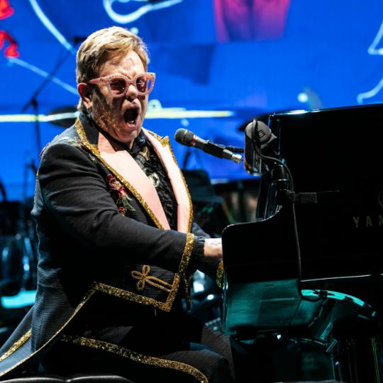 "Elton John performs during the ""Farewell Yellow Brick Road"" Tour at Spectrum Center on November 06, 2019 in Charlotte, North Carolina. (Photo by Jeff Hahne/Getty Images)"