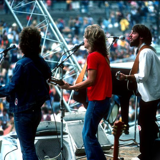 NEW YORK - 24th AUGUST: Folk rock band America perform live on stage in Central Park, New York on 24th August 1975. Left to Right: Dan Peek, Gerry Beckley and Dewey Bunnell. (Photo by Richard E. Aaron/Redferns)