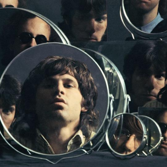 American rock band The Doors mirror their looks for a photoshoot, 1967. They are vocalist Jim Morrison, keyboardist Ray Manzarek, drummer John Densmore, and guitarist Robby Krieger. (Photo by Mark and Colleen Hayward/Getty Images)