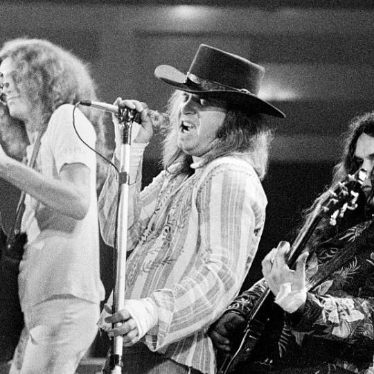 Lynyrd Skynyrd perform on stage in Rotterdam, Netherlands, 16th October 1975. L-R Allen Collins, Ronnie Van Zant, Gary Rossington. (Photo by Gijsbert Hanekroot/Redferns)