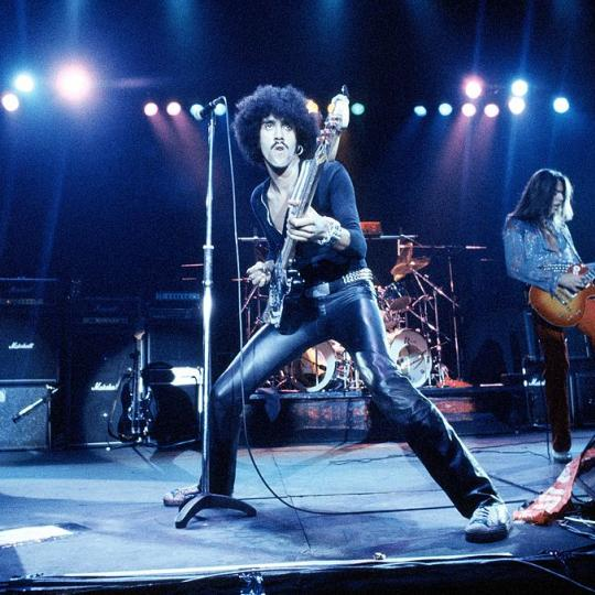 UNITED KINGDOM - JUNE 22: WEMBLEY EMPIRE POOL Photo of Scott GORHAM and Brian ROBERTSON and Phil LYNOTT and THIN LIZZY, L-R: Brian Robertson, Phil Lynott, Scott Gorham performing live onstage (Photo by Fin Costello/Redferns)
