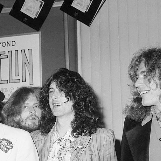 British popular musicians (left to right), drummer John Bonham (1947 - 1980), bassist and keyboardist John Paul Jones, guitarist Jimmy Page, and singer Robert Plant of the rock group Led Zeppelin appear at the West Coast premiere for their concert film 'The Song Remains the Same,' Hollywood, October 21, 1976. The film premiered in New York the night before. (Photo by Frank Edwards/Fotos international/Getty Images)