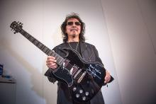 FRANKFURT AM MAIN, GERMANY - APRIL 17: Tony Iommi from the band Black Sabbath poses with his guitar 'Epiphone SG Signiture' during his visit at the 'Frankfurter Musikmesse' on April 17, 2015 in Frankfurt am Main, Germany. (Photo by Thomas Lohnes/Getty Images for Gibson)