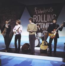 "LONDON, ENGLAND - CIRCA 1965: British Rock Group ""The Rolling Stones"" perform on a TV Show in London, England circa 1965. Left to right: : Bill Wyman, Brian Jones, Mick Jagger, Charlie Watts, Keith Richards. (Photo by Cyrus Andrews/Michael Ochs Archives/Getty Images)"