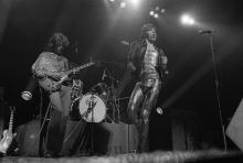 Guitarist Mick Taylor (left) and singer Mick Jagger performing with the Rolling Stones at Wembley Empire Pool, London, 7th September 1973. Drummer Charlie Watts is behind the kit. (Photo by Michael Putland/Getty Images)