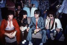 From left, British musicians Bill Wyman, Ron Wood, Mick Jagger, and Keith Richards sit on a couch at Danceteria, New York, New York, June 26, 1980. The band was there to promote their album 'Emotional Rescue'. (Photo by Allan Tannenbaum/Getty Images)