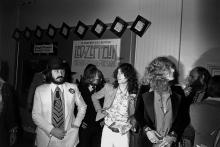 "LOS ANGELES - OCTOBER 21: Rock band ""Led Zeppelin"" arrive for the premiere of their concert film ""The Song Remains The Same"" at the Fox Wilshire theater on October 21, 1976 in Los Angeles, California. (L-R) John Bonham, John Paul Jones, Jimmy Page, Robert Plant) (Photo by Michael Ochs Archives/Getty Images)"