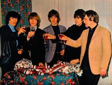 The Rolling Stones toast to their success, 1965
