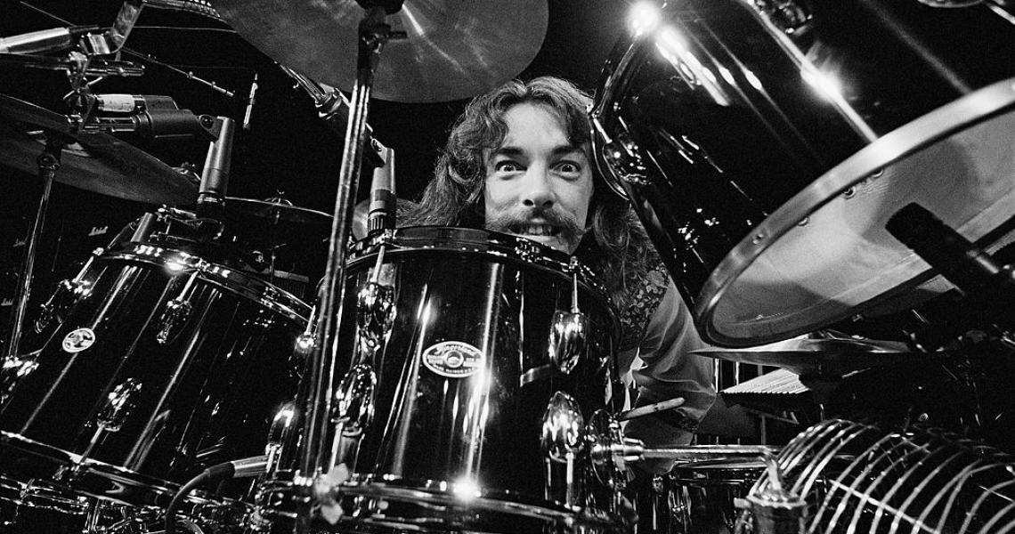 Drummer Neil Peart from Canadian band Rush performs live on stage at the Aragon Ballroom in Chicago, Illinois during their All The World's a Stage tour on 20th May 1977. (Photo by Fin Costello/Redferns)