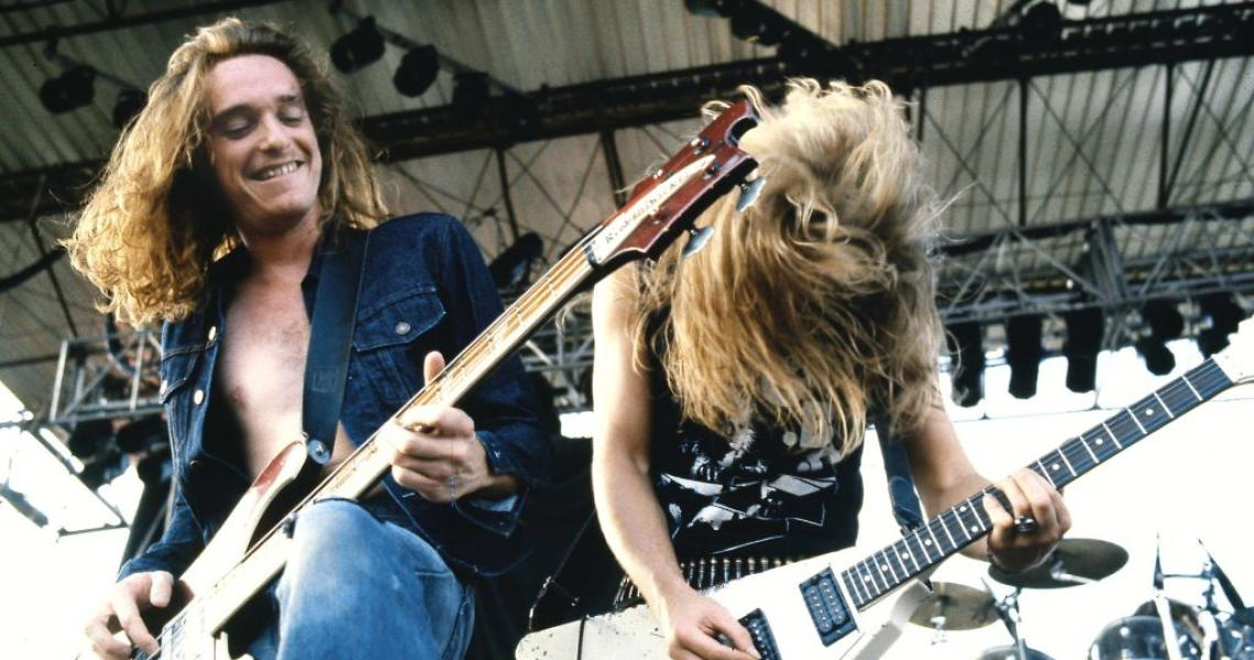 UNITED KINGDOM - JANUARY 01: Photo of METALLICA and Cliff BURTON and James HETFIELD; Cliff Burton (playing Rickenbacker bass) and James Hetfield (playing Gibson Flying V guitar) performing live onstage (Photo by Pete Cronin/Redferns)