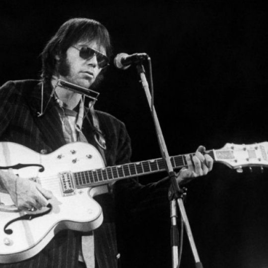Neil Young performing in England.